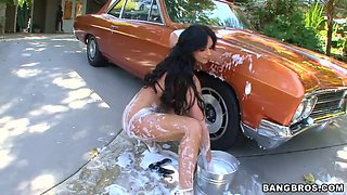 big tits round ass girl phoenix marie washing a car outdoor and getting wet