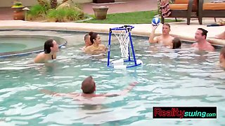 swingers get together in the pool for some steamy pre party time