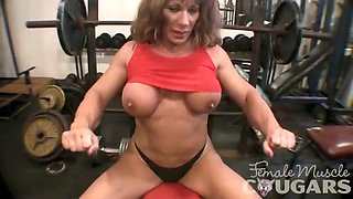 Mature Muscular Woman Plays With Big Clit