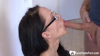 Geeky brunette chick riding a hard cock