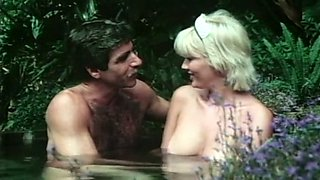 Sweet and busty blondie joins a hairy guy in the hottub outside