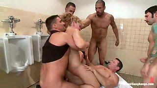 Bootyful Romanian blonde is fucked by several furious studs in a public toilet