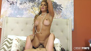 Mercedes Carrera wears nothing but stockings while she fucks