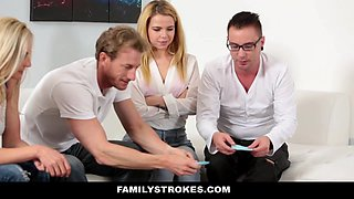Two married couples are playing sex games and enjoy foursome