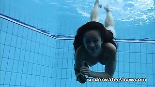 Cute Umora is swimming nude in the pool