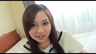 Cute Yuu Sakura in her schoolgirl uniform fingers her pussy