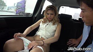 Blonde Japanese girl fucks two guys in her car