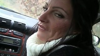 Dark haired MILFie hooker provides my buddy with handjob in the car