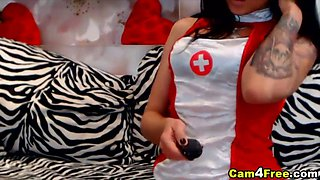 busty latina chick in a nurse outfit plays with her pussy
