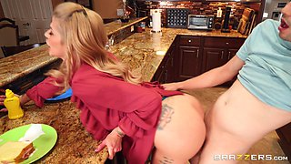 Horny cougar Joslyn James seduces a younger man in the kitchen