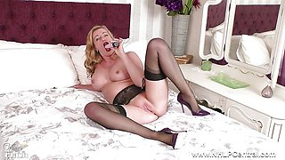 Sexy Milf toys wet pussy in nylons high heels garters