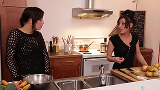 Three awesome brunettes wearing aprons share a wang in the kitchen