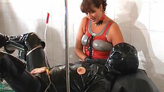 Twin rubber dommes. CBT