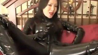 Asian Latex Dominatrix Pegging Her Gimp
