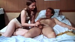 Cute white European brunette on the bed feeds on a dick
