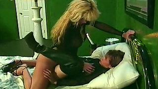 Voracious blonde milf fucks her brunette friend with a strapon