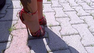 High Heels Red Sandals And Copper Nylon Stockings