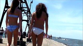 British coed girls on a vacation wear tight bikinis to the beach