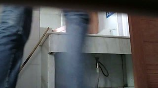 Thin Asian chick pissing and wiping in the public toilet voyeur video