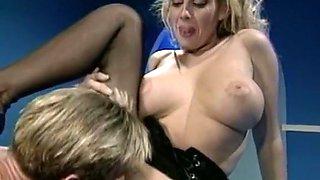 Sensational vintabe busty blondie feeds on a big dick and receives cumshot