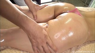 Oiled up babe Uchida Atsuko spreads her legs for a buzzing toy