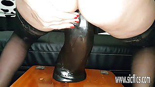 Sarah fucks massive dildos in her greedy pussy