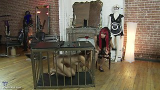 Redhead mature mistress lets her slave out f the cage to abuse her