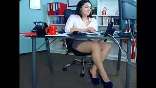 This MILF is pleasuring herself at work and she is loving every second