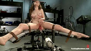 sexy brunette has a great time with a machine