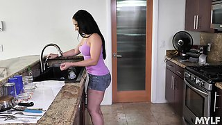 Teasing room-mate Sheena Ryder plays with her pussy in the kitchen