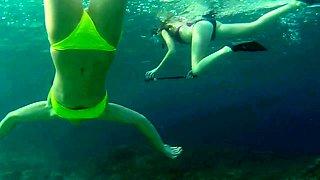 Beach voyeur films sexy babes in short bikinis under water