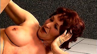 Hot redhead milf with big natural hooters takes a hard cock for a ride