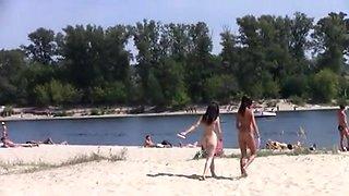 This immature nudist strips bare at a public beach