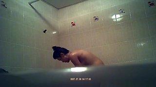 Asian woman spied showering in bathtub