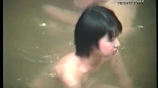 Cute Japanese naked babes in the pool are being spied on