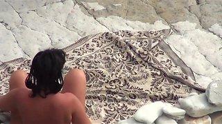 At a public beach man share his wife with a stranger voyeur