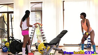 Ebony lesbian babe pussylicked at the gym