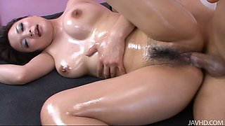 Sensuous brunette Yuu Haruka all oiled up and fucked doggy style