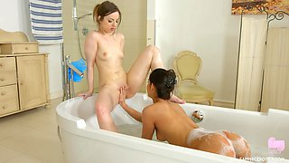 Angela Allison and Lilit Sweet eat out each other in the bathtub