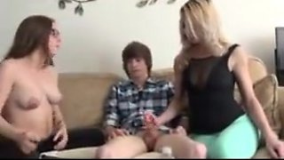 Sisters without shirts jerk a junior guy