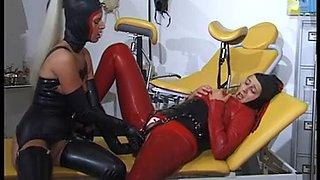 Slutty babes in femdom latex threesome