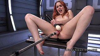 Spanish redhead has orgasms on fucking machine