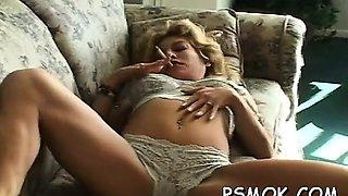 Mature slut blows a lad while smoking a cigarette