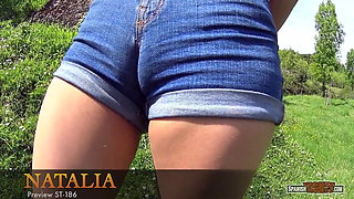Girl with denim tight shorts on display