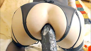 Shemale Doll Shoving A Huge Dildo Up Her Anus