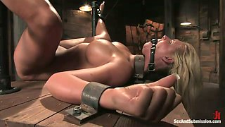 Restrained busty chick with ball gag in her mouth hole gets her pussy punished