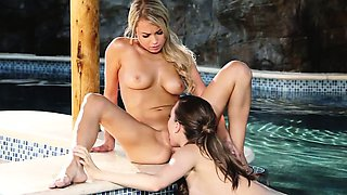 Young lesbian models get naughty in pool