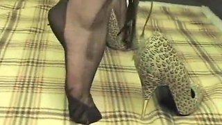 Foot tease in brown stockings 3