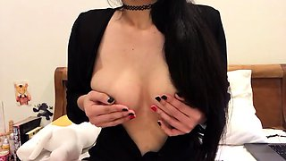 Bodacious brunette camgirl sensually caresses her nipples
