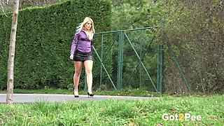 Juicy blonde office girl in the park pissing on the bench